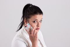 Lady Doctor in Clinical Clothes is Calling to Patient. Lady Doctor in Clinical Outfit is Calling to Patient Royalty Free Stock Image