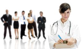 Lady doctor with colleagues royalty free stock photography