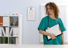 Lady doctor  holding blank clipboard Royalty Free Stock Photography