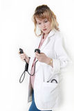 Lady doctor holding blood pressure cuff stock image