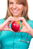 Lady doctor is holding a red apple Royalty Free Stock Photo
