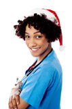Lady doctor with santa cap Stock Photos