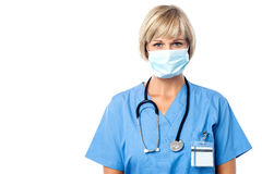 Lady doctor wearing surgical mask Royalty Free Stock Photography