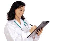 Lady doctor writing Stock Photo