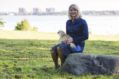 Lady with a dog near the seaside Stock Photography