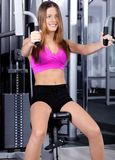Lady doing chest press Stock Photo