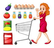 Lady doing grocery shopping Royalty Free Stock Photos