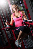 A lady doing a hanging leg raise. Image  of a fit female on a fitness machine Stock Images