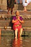 Lady doing prayer in Varanasi Ganges royalty free stock photos
