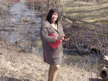 Lady by Drainage Ditch Stock Photos