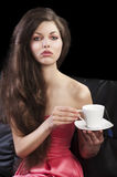 Lady drinkig tea, she take a cup of tea Royalty Free Stock Image