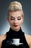 Lady drinking coffee. Beautiful lady drinking coffee. Retro portrait Royalty Free Stock Image