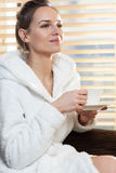 Lady drinking coffee in spa. Lady drinking coffee in a spa, vertical Stock Photos