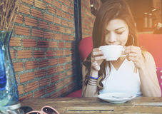 Lady drinking coffee Stock Photo