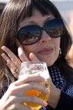 Lady drinking a glass of beer Royalty Free Stock Photography