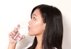 Lady drinking a glass of water Royalty Free Stock Photo