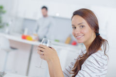 Lady drinking glass wine man cooking Royalty Free Stock Images