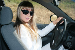 Lady-driver in the car. Lady-driver in the passenger compartment Royalty Free Stock Photography