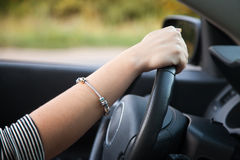 Lady driver hand Royalty Free Stock Images