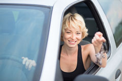Lady, driving showing car keys out the window. Stock Photo