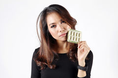 Lady eat pill for fear on obesity or beauty vitamin Royalty Free Stock Images