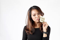 Lady eat pill for fear on obesity or beauty vitamin Royalty Free Stock Image