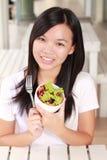 Lady eat vegetable salad Royalty Free Stock Photo