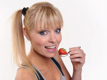 Lady eating a strawberry Royalty Free Stock Photos