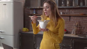 Lady eats noodles use chopsticks stock footage