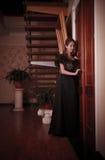 Lady eavesdropping near closed door Royalty Free Stock Photos