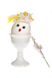 Lady egg. Funny egg with hat, face and googly eyes royalty free stock photos