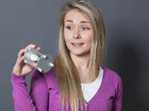 Lady with egg timer concerned about time Stock Image
