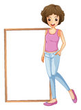 A lady with an empty board at her side Royalty Free Stock Images