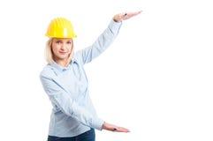 Lady engineer wearing helmet showing big copy space Stock Photo
