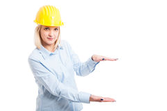 Lady engineer wearing helmet showing copy space Royalty Free Stock Images