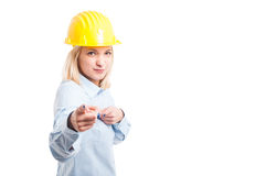 Lady engineer wearing yellow pointing at camera Stock Photo