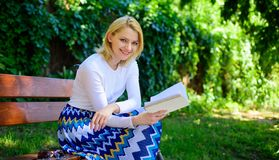 Lady enjoy poetry in garden. Romantic poem. Enjoy rhyme. Woman happy smiling blonde take break relaxing in garden. Reading poetry. Girl sit bench relaxing with stock images