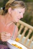 Lady Enjoying a Bowl of Paella Royalty Free Stock Photos