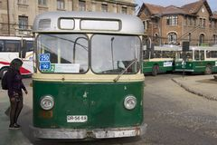 Lady enters old trolleybus in Valparaiso, Chile Royalty Free Stock Image