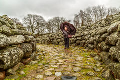 Lady in an entrance to a bronze age grave Royalty Free Stock Photos