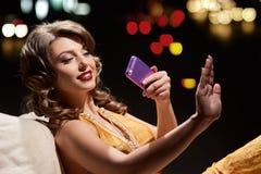 Lady Examines Manicure Royalty Free Stock Photos