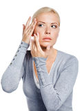 Lady examining her face Royalty Free Stock Photography