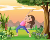 A lady exercising near a big tree Stock Images