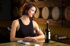 Lady at an expensive luxury restaurant with a bottle of wine elegant classy Royalty Free Stock Photo