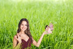Lady with a fairy Stock Images