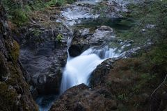 Lady Falls, Waterfall, Strathcona Provincial Park near Campbell River, British Columbia, Canada, long exposure to smooth stock image