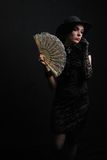 Lady with a fan Royalty Free Stock Photography