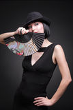 Lady with a fan Stock Images