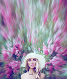 Lady in a fantastic world of flowers Stock Images