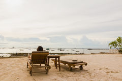 Lady feel relax on bed beach on holiday. At sriracha thailand Royalty Free Stock Image
